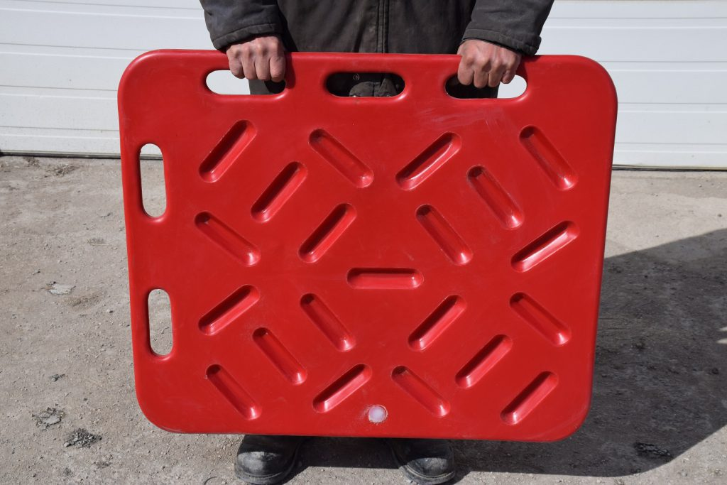man holding a red hog sorting board