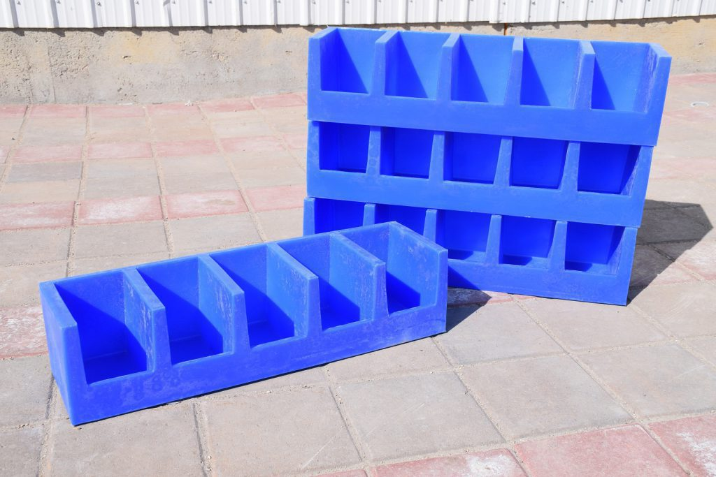 four blue plastic bolt bins stacked